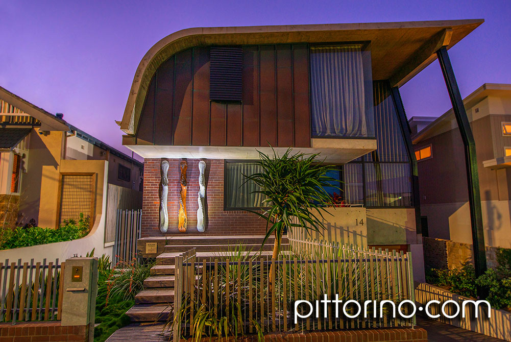 architect designed house featuring 'na ho'okele' timber and glass fibre reinforced concrete outdoor totem sculptures Sydney Eastern Suburbs, Australia