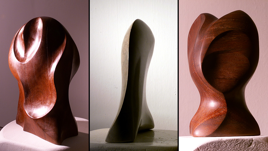 two timber sculptures and a marble sculpture